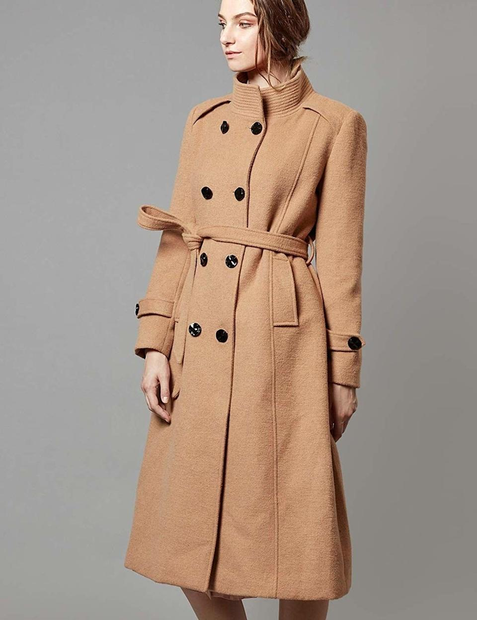 """With a classic look, tie waist and natural color, you'll wear this coat for years. Plus, it's made with 50% wool to keep you warm but not looking like a marshmallow.<br /><br /><strong>Promising review:</strong>""""This jacket is beautiful — the color is great, the fit is great. Most importantly, this jacket is warm. I live in the Midwest, so cute jackets are fine, but I need something that's going to stand up to a Midwestern winter, and this one does. I ordered a large. I could have gotten a medium, but the large gives me room for thicker sweaters. 10/10 would order again."""" —<a href=""""https://amzn.to/2OTe162"""" target=""""_blank"""" rel=""""nofollow noopener noreferrer"""" data-skimlinks-tracking=""""5753950"""" data-vars-affiliate=""""Amazon"""" data-vars-href=""""https://www.amazon.com/gp/customer-reviews/R1FLQEZNIMHZSP?tag=bfabby-20&ascsubtag=5753950%2C10%2C30%2Cmobile_web%2C0%2C0%2C0"""" data-vars-keywords=""""cleaning,fast fashion"""" data-vars-link-id=""""0"""" data-vars-price="""""""" data-vars-retailers=""""Amazon"""">Andrea</a><br /><br /><strong>Get it from Amazon for<a href=""""https://amzn.to/3goh6Gu"""" target=""""_blank"""" rel=""""nofollow noopener noreferrer"""" data-skimlinks-tracking=""""5753950"""" data-vars-affiliate=""""Amazon"""" data-vars-asin=""""B074W6NCJ5"""" data-vars-href=""""https://www.amazon.com/dp/B074W6NCJ5?tag=bfabby-20&ascsubtag=5753950%2C10%2C30%2Cmobile_web%2C0%2C0%2C15956635"""" data-vars-keywords=""""cleaning,fast fashion"""" data-vars-link-id=""""15956635"""" data-vars-price="""""""" data-vars-product-id=""""18304389"""" data-vars-product-img=""""https://m.media-amazon.com/images/I/41z1G9g27-L.jpg"""" data-vars-product-title=""""Escalier Women's Wool Trench Coat Winter Double-Breasted Jacket with Belts"""" data-vars-retailers=""""Amazon"""">$129.99</a>(available in sizes XS-3X and in three colors).</strong>"""