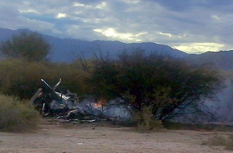 The burning wreckage of two helicopters which collided mid-air near Villa Castelli, in the Argentine province of La Rioja, on March 9, 2015