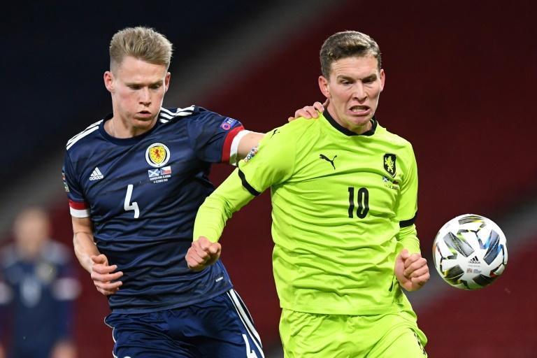 Clarke stays calm as confident Scotland roll on to Euros playoff