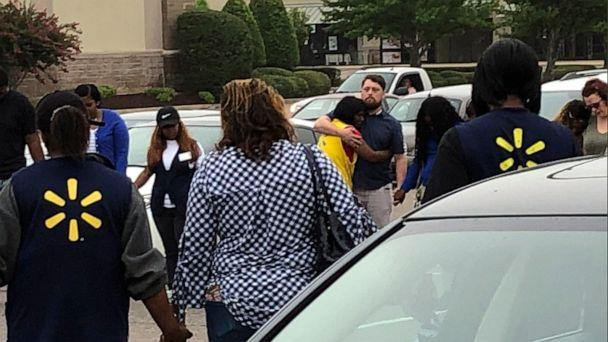 PHOTO:Walmart employees join in a prayer circle outside the store, July 30, 2019, in Southaven, Miss. (Jerrita Patterson/WREG-TV via AP)