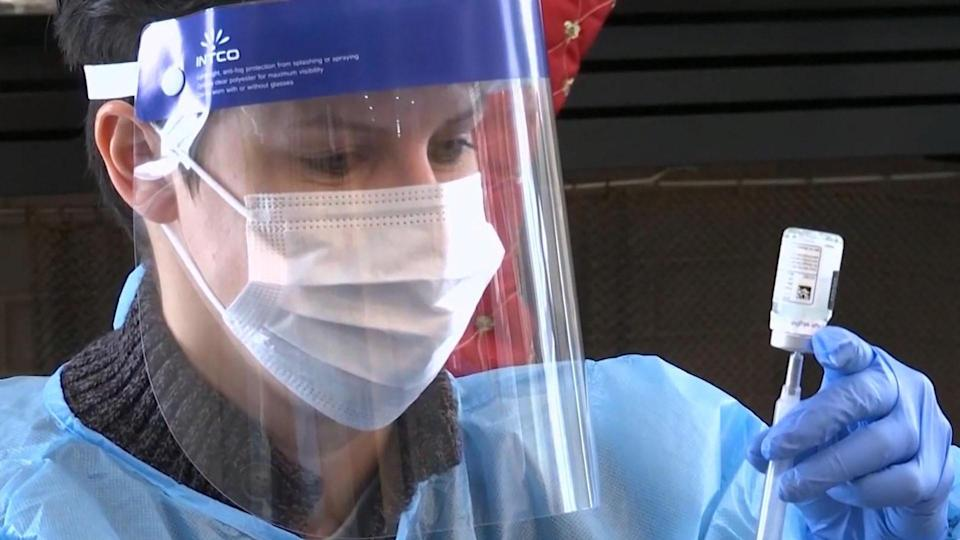 A healthcare worker prepares to administer the COVID-19 vaccine. / Credit: CBS News
