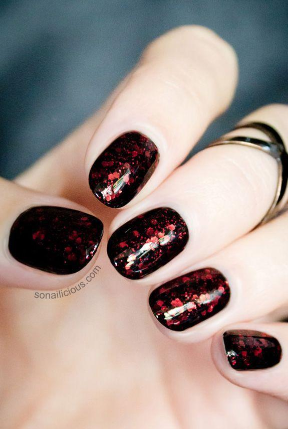 "<p>Give your black polish a creepy-cool upgrade with dark red glitter — it's a subtle nod to Halloween without being too over the top. </p><p><a href=""http://sonailicious.com/dance-legend-rich-black-915-burgundian-sky/"" rel=""nofollow noopener"" target=""_blank"" data-ylk=""slk:Get the tutorial at So Nailicious »"" class=""link rapid-noclick-resp""><em>Get the tutorial at So Nailicious »</em></a><br> </p>"