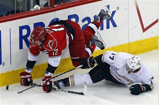 Carolina Hurricanes' Eric Staal (12) tussles with Anaheim Ducks' Lubomir Visnovsky (17), of Slovakia, during the second period of an NHL hockey game in Raleigh, N.C., Thursday, Feb. 23, 2012. (AP Photo/Karl B DeBlaker)