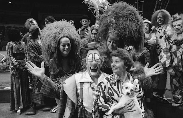 <p>Lou Jacobs, center, whose face has appeared on Ringling Brothers and Barnum and Bailey circus posters for the past 30 years, poses with his wife Jean, holding his dog Knucklehead, and daughters Dolly and Lou Anne, left and right, both circus show girls, before the circus' performance, May 16, 1973. Jacobs, who had has been making smiles in the circus for 50 years is also celebrating his 70th birthday at the main arena of Madison Square Garden in New York. Dolly Jacobs is 16, Lou Anne, 18. (AP Photo/Anthony Camerano) </p>