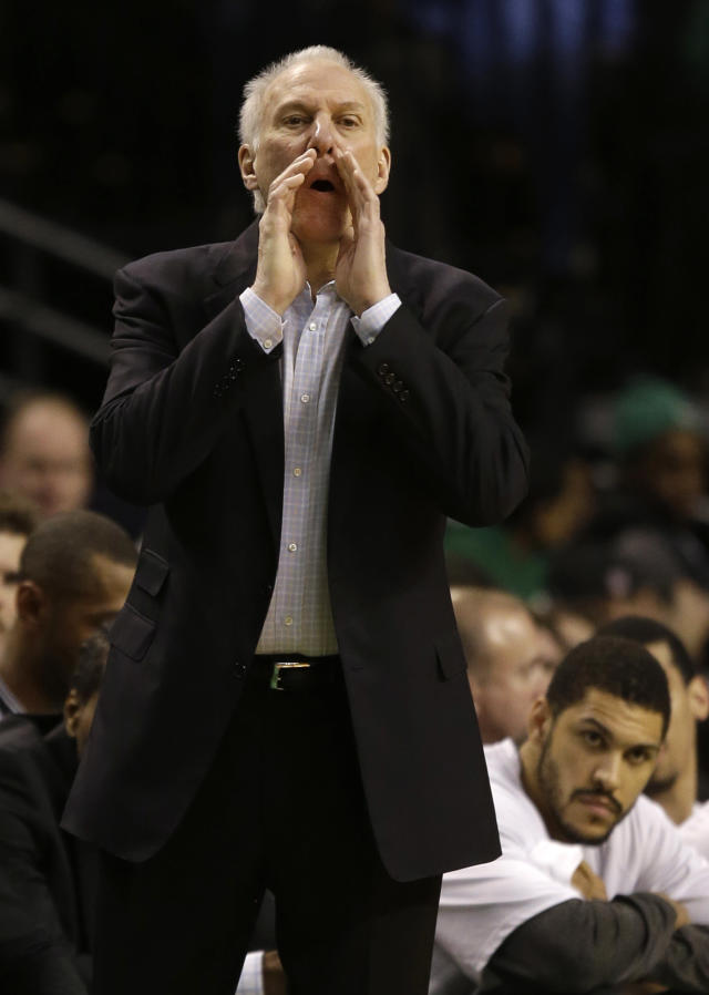 San Antonio Spurs coach Gregg Popovich shouts instructions to his team as they work their offense during the first half of an NBA basketball game against the Boston Celtics in Boston, Wednesday, Feb. 12, 2014. (AP Photo/Stephan Savoia)