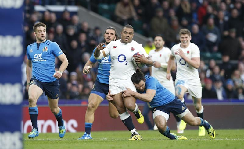 England's Kyle Sinckler goes on the charge during the Six Nations rugby union match between England and Italy at Twickenham stadium in London, Sunday, Feb. 26, 2017. (AP Photo/Alastair Grant)
