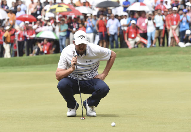 Marc Leishman of Australia aligns his putt on the eighteenth hole during final round of the CIMB Classic golf tournament at Tournament Players Club (TPC) in Kuala Lumpur, Malaysia, Sunday, Oct. 14, 2018. (AP Photo/Yam G-Jun)