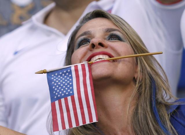 A U.S. fan cheers before the 2014 World Cup round of 16 game between Belgium and the U.S. at the Fonte Nova arena in Salvador July 1, 2014. REUTERS/Marcos Brindicci (BRAZIL - Tags: SOCCER SPORT WORLD CUP)