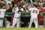Boston Red Sox's Daniel Nava (29) celebrates after scoring on a sacrifice fly by A.J. Pierzynski during the fifth inning of a baseball game against the Minnesota Twins in Boston, Monday, June 16, 2014. (AP Photo/Michael Dwyer)
