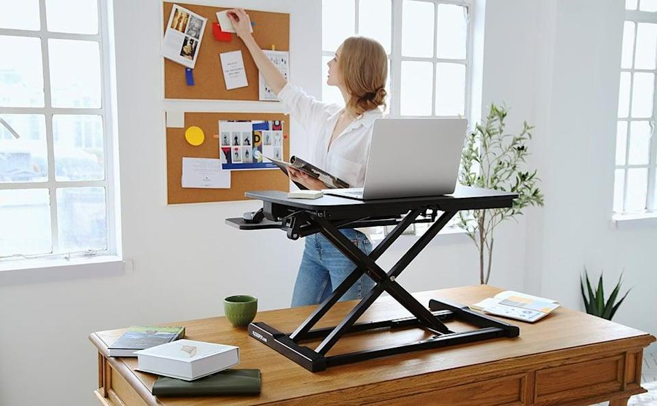 <p>If you already have a desk that you love, use this <span>Flexispot Stand Up Desk Converter</span> ($100) to turn it into a standing desk.</p>