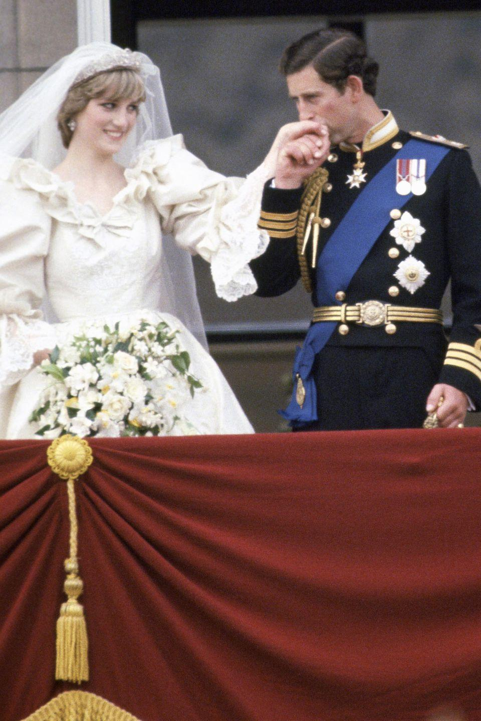 <p>With his wife, Princess Diana, on the balcony of Buckingham Palace on their wedding day. </p>