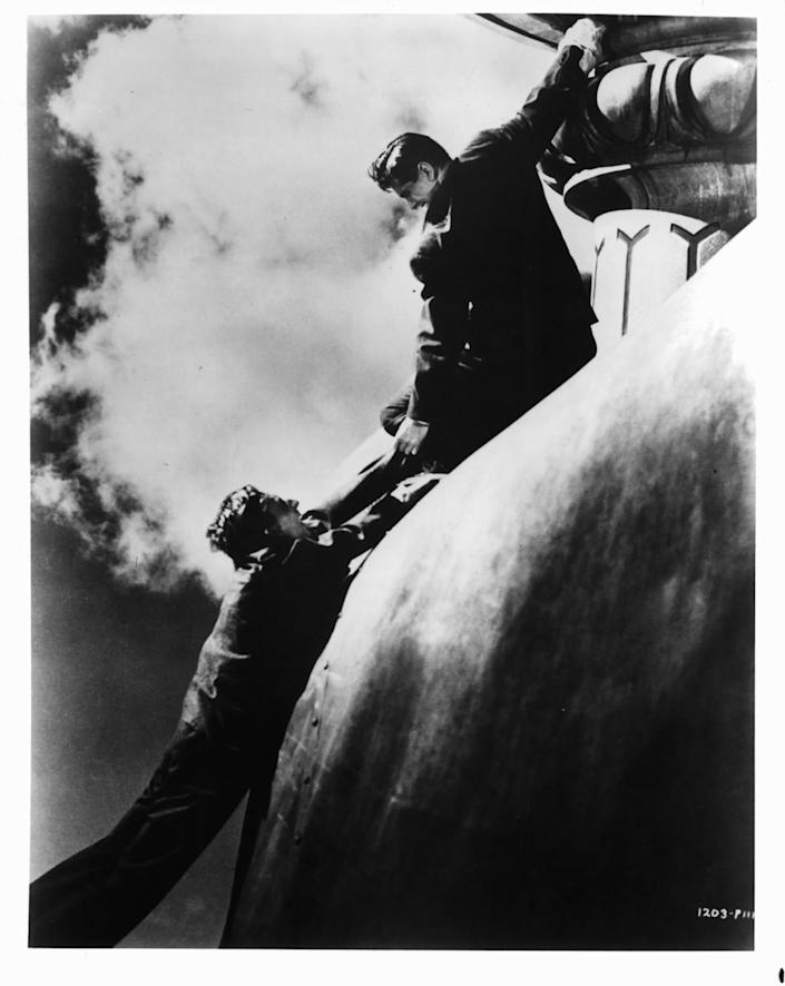 Norman Lloyd, left, and Robert Cummings fighting on top of the Statue of Liberty in a scene from the film 'Saboteur,' 1942.