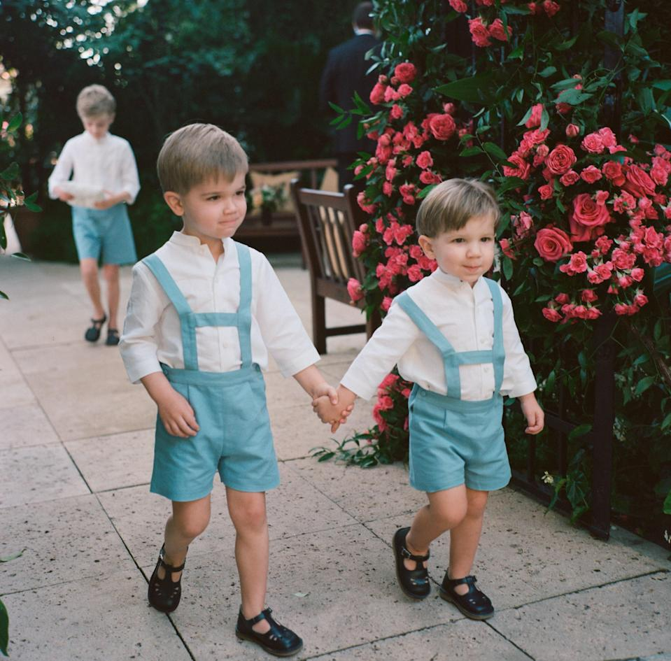 We didn't have bridesmaids or groomsmen, but we did have six nieces and nephews in our wedding party. Here you see our page boys—my brother Justin's sons—processing, followed by our ring bearer—Thomas's sister's son.