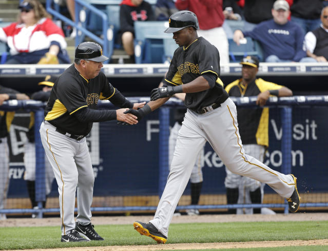 Pittsburgh Pirates right fielder Gregory Polanco is greeted by third base coach Nick Leyva, left, after hitting a home run during the first inning of an exhibition baseball game against the New York Yankees Thursday, Feb. 27, 2014, in Tampa, Fla. (AP Photo/Charlie Neibergall)