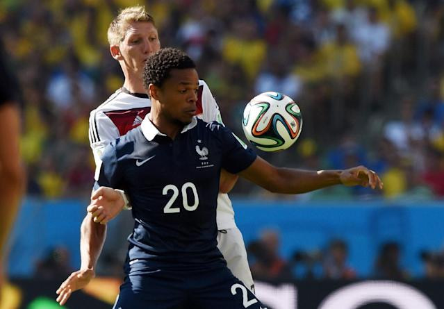 Loic Remy (front) fends off Bastian Schweinsteiger during the World Cup quarter-final between France and Germany at the Maracana Stadium in Rio de Janeiro on July 4, 2014 (AFP Photo/Pedro Ugarte)