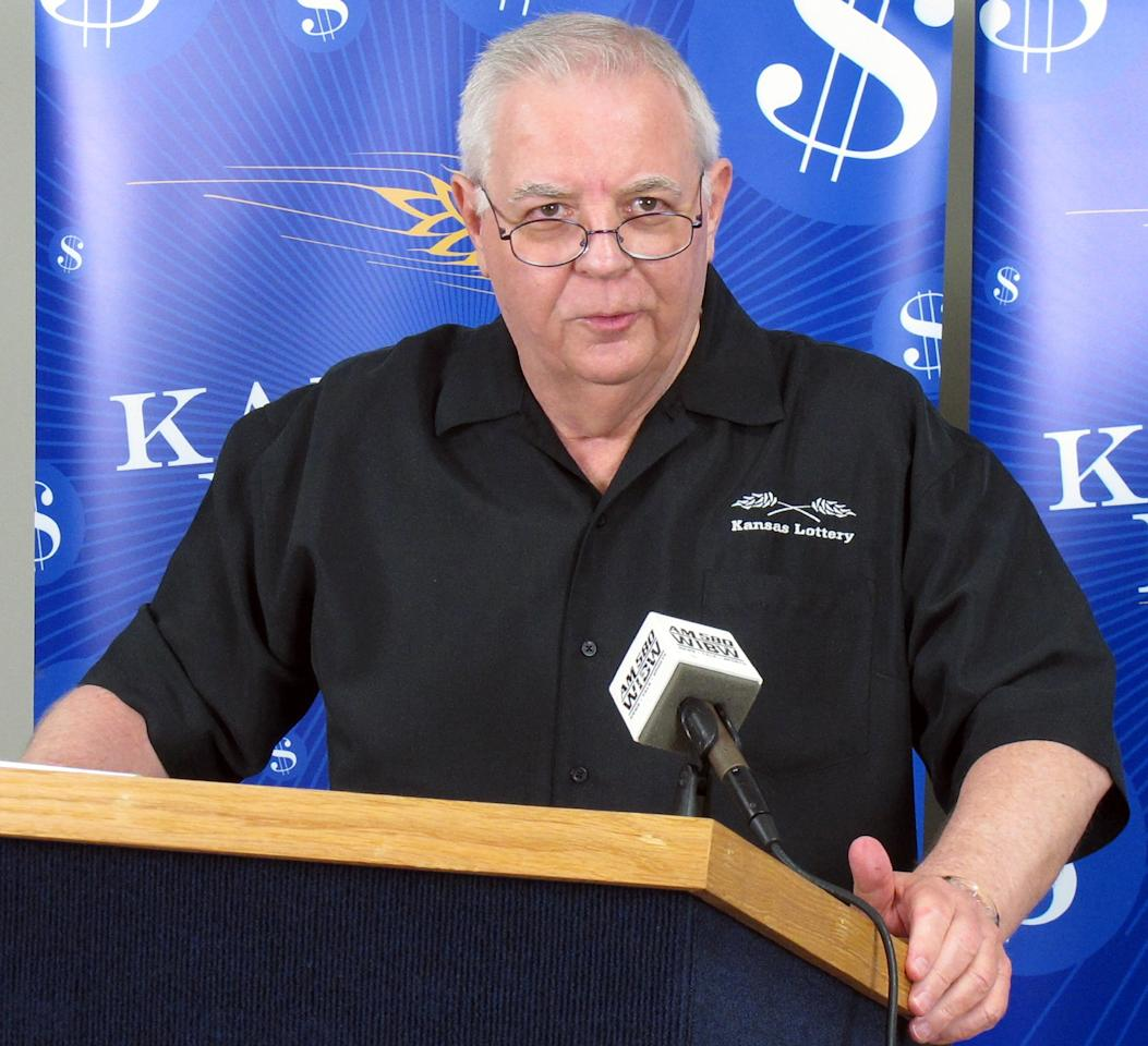 Dennis Wilson, the Kansas Lottery's executive director, answers questions from reporters about the winning Mega Millions ticket sold in northeast Kansas, Saturday, March 31, 2012, in Topeka, Kan. Winning tickets were sold in Kansas, Illinois and Maryland for a share of an estimated $640 million jackpot. (AP Photo/John Hanna)