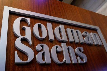 A Goldman Sachs sign is displayed inside the company's post on the floor of the NYSE in New York