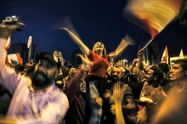 Footage from the protests-turned-raves has gone viral on social media networks, encouraging protesters from across northern Lebanon to join the Tripoli demonstrations, even Christians from neighbouring areas (AFP Photo/Ibrahim CHALHOUB)