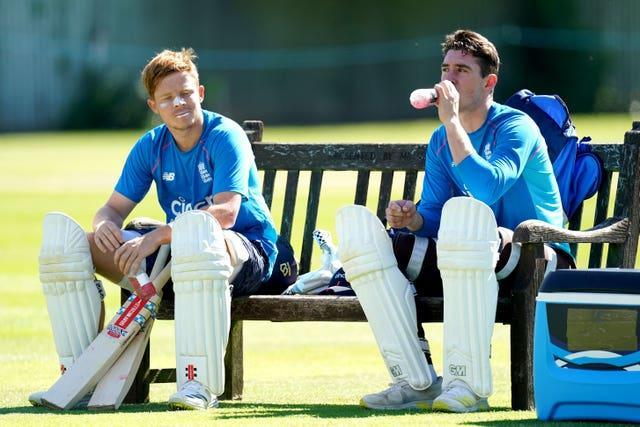 Ollie Pope (left) and Daw Lawrence (right) are waiting to step up off the bench.