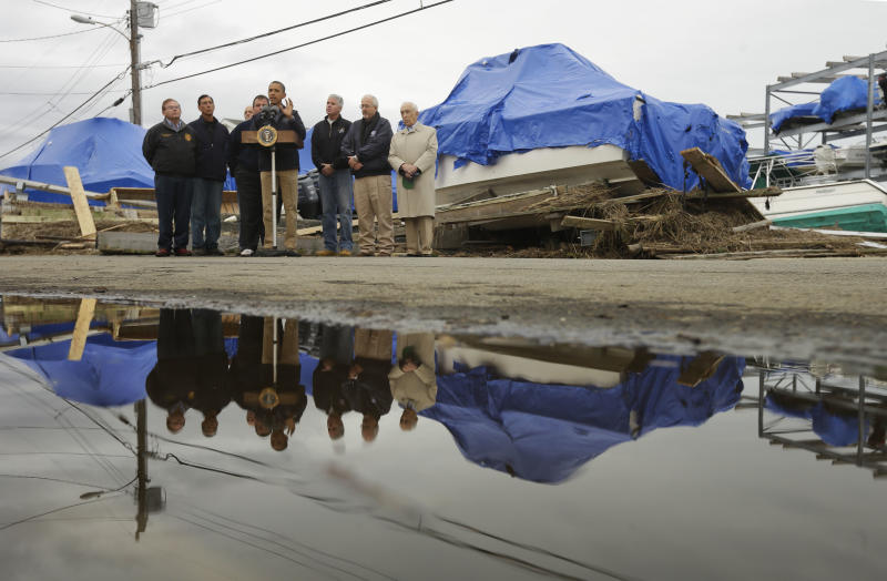 President Barack Obama, center, with New Jersey Gov. Chris Christie, Federal Emergency Management Agency administrator Craig Fugate, and other local and federal officials, speak about the relief efforts causes by the effect of superstorm Sandy, while standing in front of North Point Marina, Wednesday, Oct. 31, 2012, in Brigantine, N.J. (AP Photo/Pablo Martinez Monsivais)