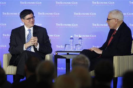 U.S. Treasury Secretary Lew smiles as he speaks with Carlyle Group co-CEO Rubenstein during an onstage interview in Washington