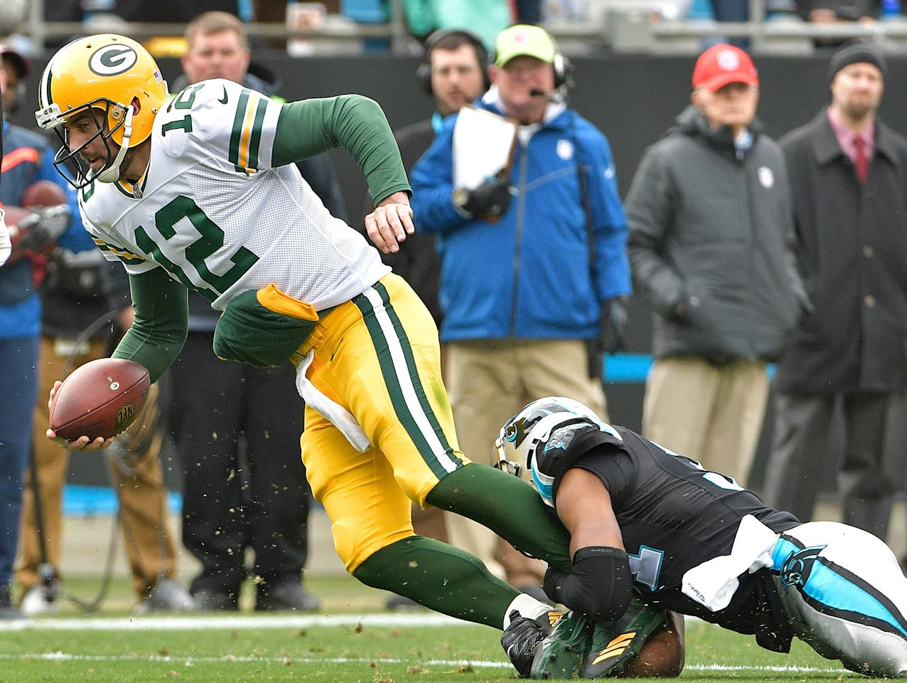 <p>Jairus Byrd #31 of the Carolina Panthers tackles Aaron Rodgers #12 of the Green Bay Packers during their game at Bank of America Stadium on December 17, 2017 in Charlotte, North Carolina. (Photo by Grant Halverson/Getty Images) </p>