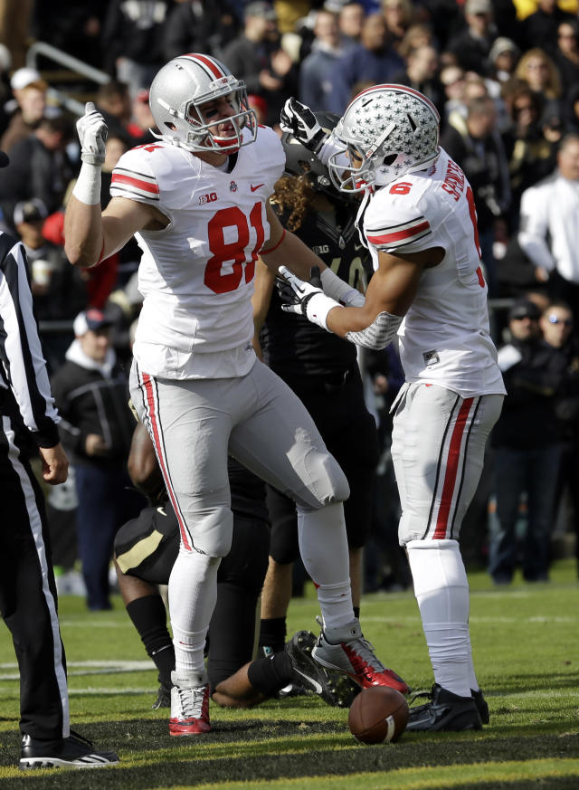 Ohio State tight end Nick Vannett, left, celebrates scoring a touchdown against Purdue with wide receiver Evan Spencer during the first half of an NCAA college football game in West Lafayette, Ind., Saturday, Nov. 2, 2013. (AP Photo/Michael Conroy)