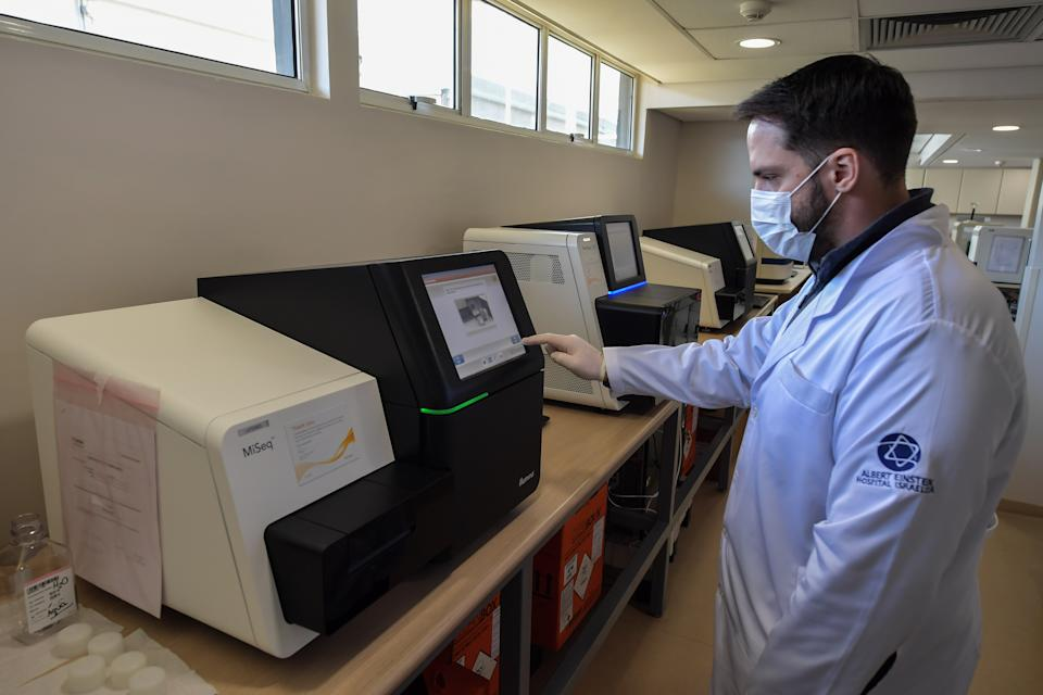 A researcher works at the special techniques laboratory where a genetic test was developed to diagnose the new coronavirus, COVID-19, at Albert Einstein Israelite Hospital, in Sao Paulo, Brazil, on May 28, 2020. - The Israelite Albert Einstein Hospital in Sao Paulo developed a genetic methodology to detect covid-19 that, it says, could exponentially expand the diagnostic capacity of Brazil, where the lack of tests makes it difficult to combat the pandemic. (Photo by NELSON ALMEIDA / AFP) (Photo by NELSON ALMEIDA/AFP via Getty Images)