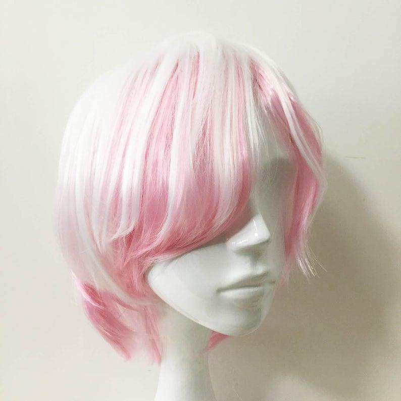 """<h3>White Pink Ombre Long Bangs Short Hair Cosplay Wig</h3> <br>If you're looking for a Cardi B-style two-toned wig, you can find many chic (and affordable) styles on Etsy.<br><br><strong>nevermindyrhead</strong> White Pink Ombre Long Bangs Short Hair Cosplay Wig Free Cap, $, available at <a href=""""https://go.skimresources.com/?id=30283X879131&url=https%3A%2F%2Fwww.etsy.com%2Flisting%2F618547371%2Fwhite-pink-ombre-long-bangs-short-hair%3Fgpla%3D1%26gao%3D1%26"""" rel=""""nofollow noopener"""" target=""""_blank"""" data-ylk=""""slk:Etsy"""" class=""""link rapid-noclick-resp"""">Etsy</a><br>"""