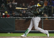 Oakland Athletics' Jurickson Profar hits an RBI-single against the San Francisco Giants during the first inning of an exhibition baseball game in San Francisco, Monday, March 25, 2019. (AP Photo/Jeff Chiu)