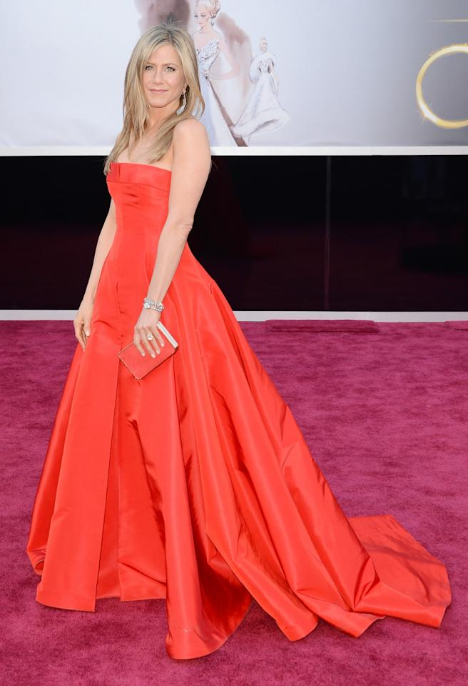 <p>Jennifer wore an unusual – yet still winning – choice to the 2013 Oscars, dressing in a vibrant red Valentino ballgown. <i>[Photo: Getty]</i> </p>