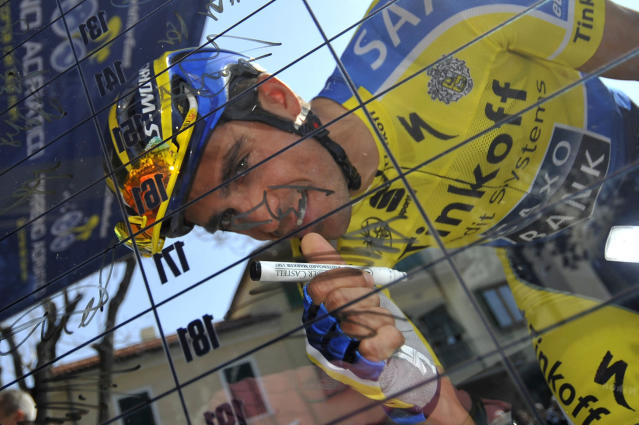 Spain's Alberto Contador puts his signature at the start of the second stage of the Tirreno Adriatico cycling race from San Vincenzo to Cascina, Italy, Thursday, March 13, 2014. Italy's Matteo Pelucchi edged Arnaud Demare and Andre Greipel after making his move 100 meters from the end of the 166-kilometer (103-mile) leg from San Vincenzo to Cascina for the biggest win of his career. Britain's Mark Cavendish finished a disappointing 17th but remains in the overall lead after he and his Omega Pharma-Quick Step team won a time trial to open the race on Wednesday. (AP Photo/Gian Mattia D'Alberto, Lapresse)