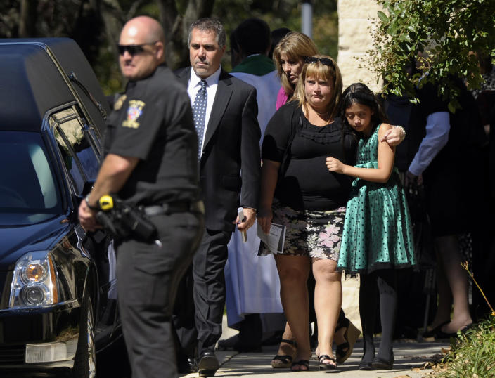 People walk out of church following the funeral service for Navy Yard shooting victim John R. Johnson at Good Shepherd Lutheran Church in Gaithersburg, Md., Tuesday, Sept. 24, 2013. (AP Photo/Susan Walsh)