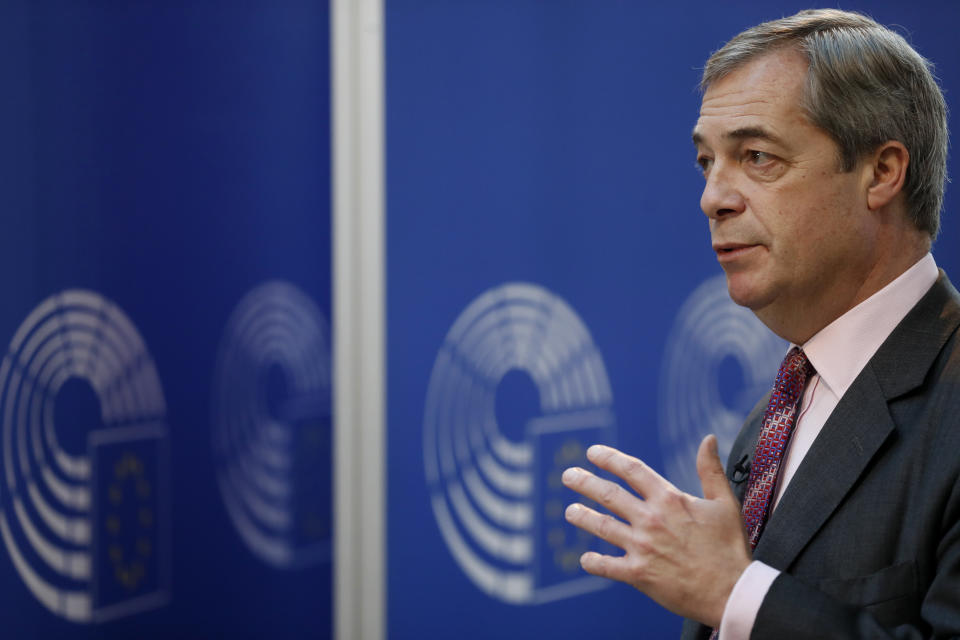 """Nigel Farage, the leader of the Brexit Party, answers reporters at the European parliament Wednesday, Jan.15, 2020 in Strasbourg, eastern France. Nigel Farage, the self-declared """"pantomime villain"""" of Brexit, is leaving his favorite theater — the European Union's parliament in Strasbourg — this week with a sense of mission accomplished. (AP Photo/Jean-Francois Badias)"""