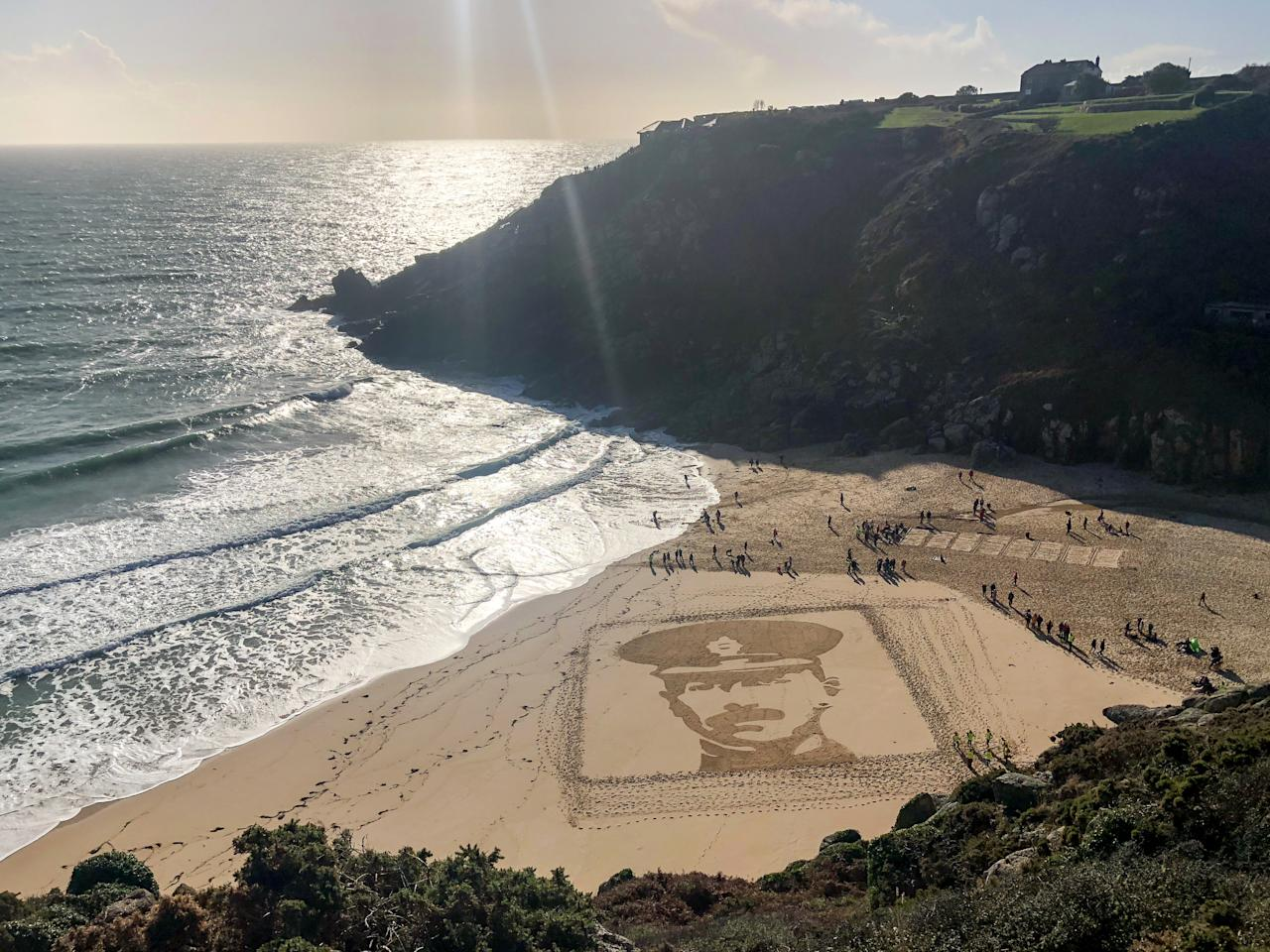 <p>People on Porthcurno beach, Cornwall, walk past a large scale sand portrait of Lieutenant Richard Charles Graves-Sawle, who was 26 when he was killed by a sniper‒s bullet near Ypres on November 2 1914. (Getty) </p>