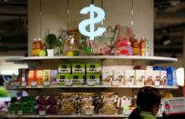 FILE PHOTO: Goods are displayed in front of a cashier at a supermarket in Hong Kong