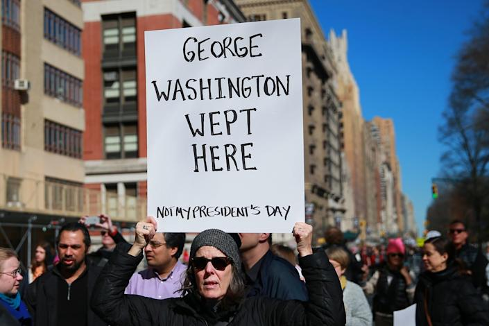 """<p>A demonstrator holds up a sign during the """"Not My President's Day"""" rally at Central Park West in New York City on Feb. 20, 2017. (Gordon Donovan/Yahoo News) </p>"""