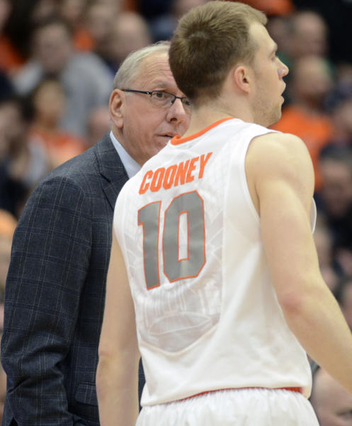Syracuse head coach Jim Boeheim, left, talks to Trevor Cooney during the first half against Louisville in an NCAA college basketball game in Syracuse, N.Y., Saturday, March 2, 2013. (AP Photo/Kevin Rivoli)