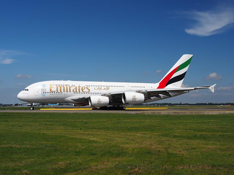 An Emirates A380 jet on the ground.