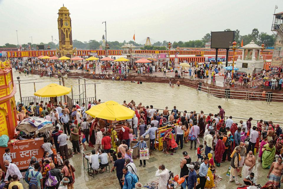 Flouting COVID protocols, devotees gather at the banks of the Ganga river on the occasion of 'Vat Purnima', at Har Ki Pauri ghat in Haridwar on Thursday, 10 June.