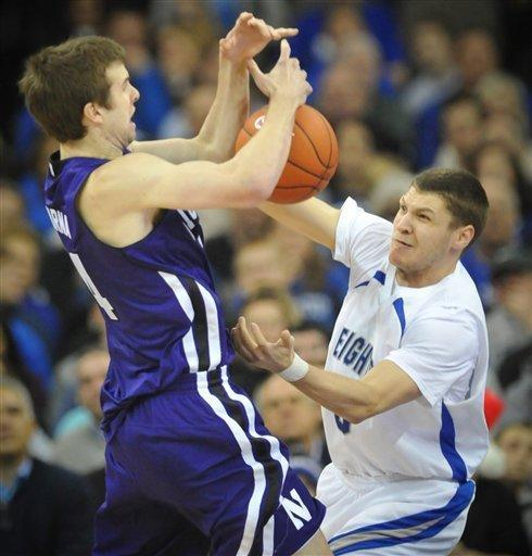 Creighton's Grant Gibbs, right, tries to steal the ball from Northwestern's John Shurna (24) during the first half of an NCAA college basketball game in Omaha, Neb., Thursday, Dec. 22, 2011. (AP Photo/Dave Weaver)