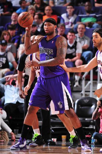 PHOENIX, AZ - MARCH 28: DeMarcus Cousins #15 of the Sacramento Kings looks to pass against the Phoenix Suns on March 28, 2013 at U.S. Airways Center in Phoenix, Arizona. (Photo by Barry Gossage/NBAE via Getty Images)