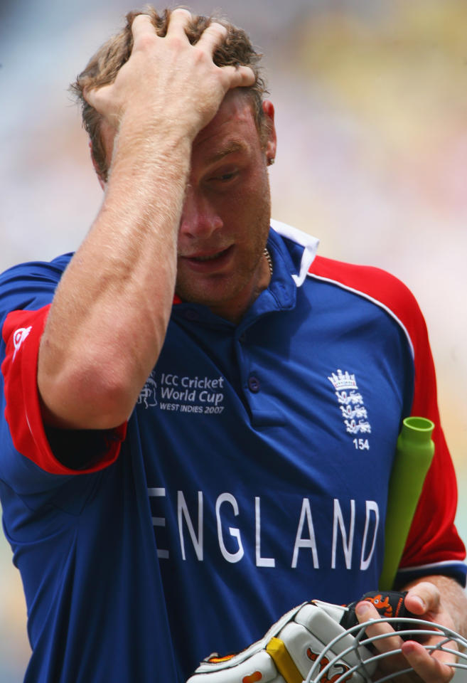 ST. JOHN'S, ANTIGUA AND BARBUDA - APRIL 08: Andrew Flintoff of England walks back after being stumped by Adam Gilchrist of Australia during the ICC Cricket World Cup Super Eights match between Australia and England at the Sir Vivian Richards Stadium on April 8, 2007 in St. John's, Antigua and Barbuda.  (Photo by Tom Shaw/Getty Images)