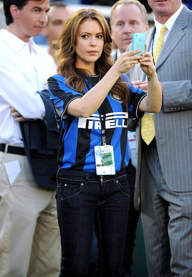 """Though she's known for being a huge baseball fan, Alyssa Milano was enjoying an up-close view of the soccer action as well. (And, of course, Twittering about it too!) IOS/London Ent/<a href=""""http://www.splashnewsonline.com"""" target=""""new"""">Splash News</a> - July 21, 2009"""