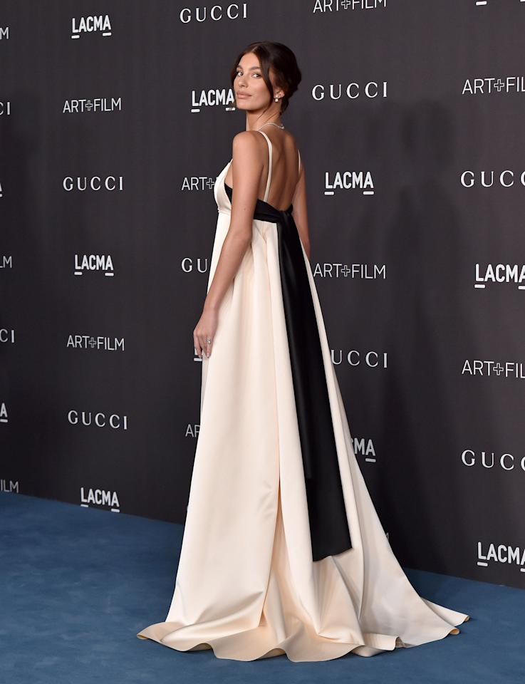 Black and white is perhaps the most classic combination in fashion, and can sometimes be considered a bit blah for red carpet events. But not here! Camila Morrone wore this whimsical white and black spaghetti-strap gown with her hair in a classic pulled-back chignon.