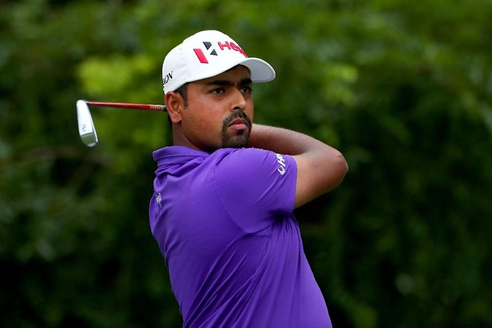 India's Anirban Lahiri missed a three-foot birdie putt at the par-5 first, but used it to help him surge to the finish (AFP Photo/TOM PENNINGTON)