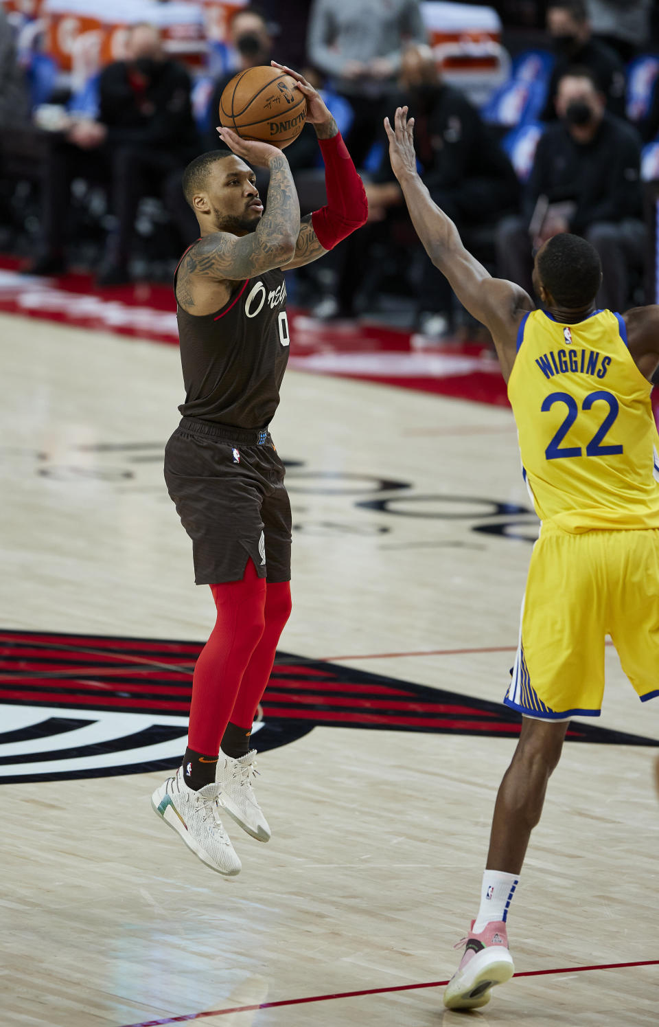 Portland Trail Blazers guard Damian Lillard shoots a 3-point basket over Golden State Warriors forward Andrew Wiggins during the second half of an NBA basketball game in Portland, Ore., Wednesday, March 3, 2021. (AP Photo/Craig Mitchelldyer)