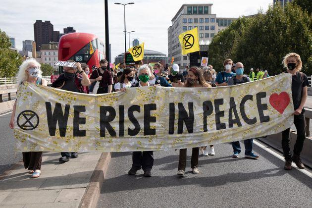 Extinction Rebellion Shell Out protest 'We rise in peace' banner on 8th September 2020 in London, United Kingdom (Photo: Mike Kemp via Getty Images)