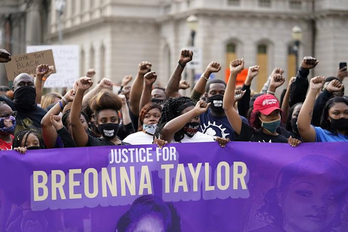In this Sept. 25, 2020, file photo, Black Lives Matter protesters march in Louisville. Hours of material in the grand jury proceedings for Taylor's fatal shooting by police have been made public on Friday, Oct. 2. (AP Photo/Darron Cummings, File)