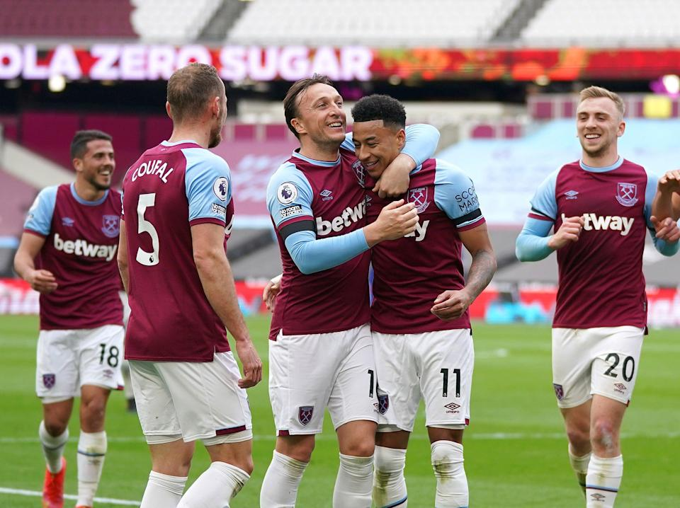 West Ham captain Mark Noble (centre left) celebrates with Jesse Lingard (Getty Images)